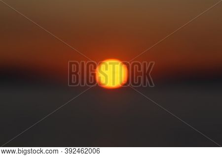 Unfocused Blured Multicolored Background Bokeh Of Sunset.