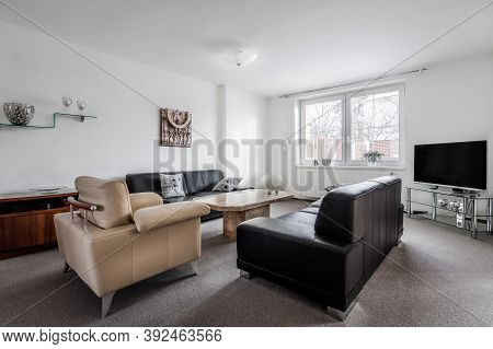 Modern Furnished Living Room In Cool Style With Big Marble Conference Table, Two Couches, One Chair