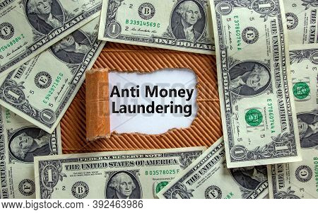 Anti Money Laundering Concept. The Text 'anti Money Laundering' Appearing Behind Torn Brown Paper. D