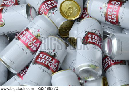 Many Tin Cans Of Stella Artois Beer Outdoors. Stella Artois Is The Most Famous Belgian Beer In The W