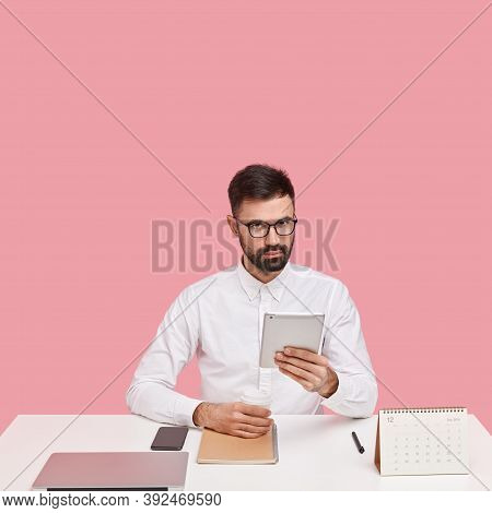 Prosperous Entrepreneur Makes Telephone Call, Reads Successful Ideas For Business On Web Page, Holds