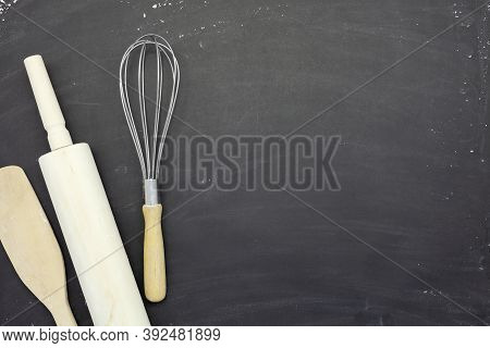 Sprinkle Wheat Flour With Rolling Pin ,wooden Spoon And  Dough Preparing Copy Space For Text On Dark