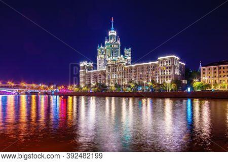 Stalin Skyscraper On Kotelnicheskaya Embankment Of The Moscow River. Night Shot Of Moscow River Refl