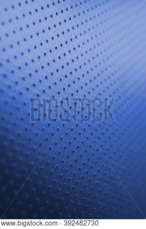 Tinted Blue Metal Background With Bright Saturated Color. Dark Vertical Wallpaper. Perforated Alumin