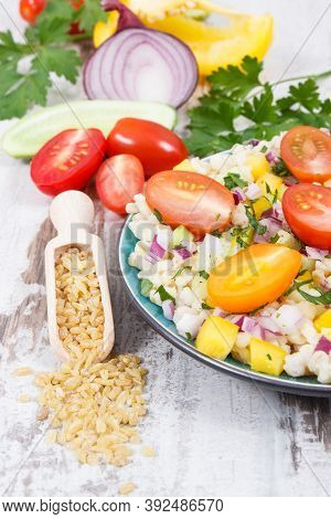 Fresh Prepared Salad With Vegetables And Bulgur Groats. Healthy Meal Containing Natural Vitamins And