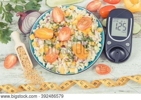 Glucose Meter For Checking Sugar Level And Fresh Salad With Bulgur Groats And Vegetables As Best Foo