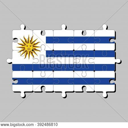 Jigsaw Puzzle Of Uruguay Flag In Horizontal Stripes Of White Alternate With Light Blue And The Sun O