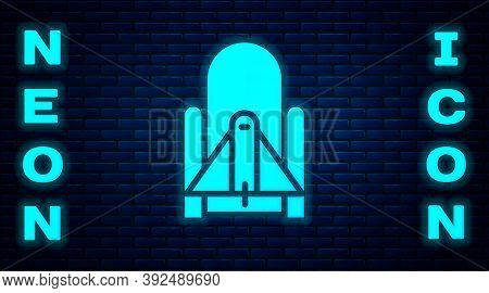 Glowing Neon Rocket Launch From The Spaceport Icon Isolated On Brick Wall Background. Launch Rocket