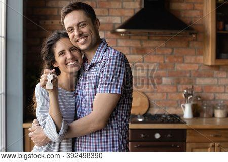 Portrait Of Happy Couple Renters Show House Keys