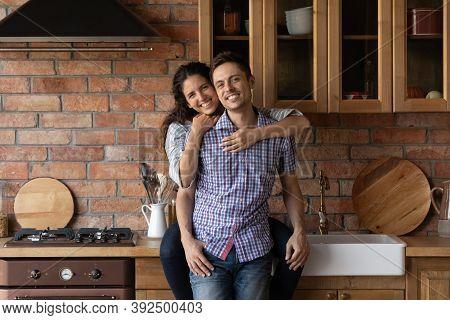 Portrait Of Happy Couple Tenants Posing In Own Kitchen