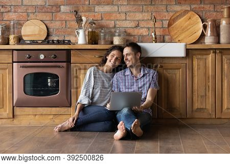 Smiling Couple Renters Relax Dreaming Of Happy Future Together