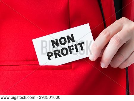 Businessman Putting A Card With Text Non Profit In The Pocket