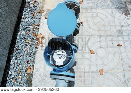 Water Meter And Metal Pipes Blue Color For Measurement Of Water Flow. Water Environmental Conservati