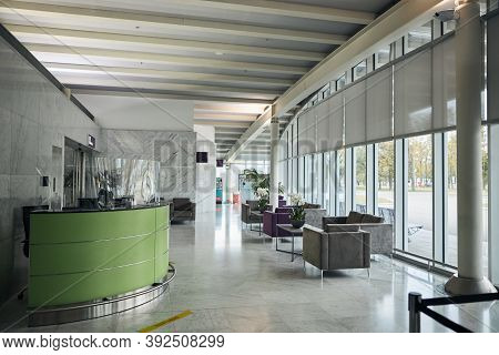 Foyer With Floor-to-ceiling Windows And Modern Furniture