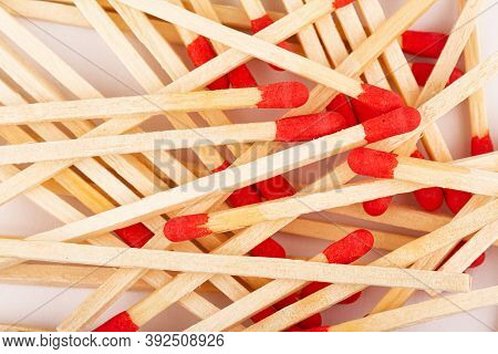 Front View Macro Closeup Of Red Wooden Match Sticks Texture On White Background