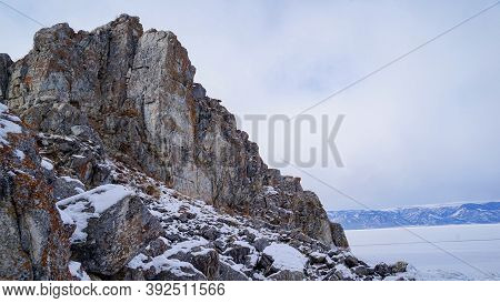 Shamanka Rock In Winter, Lake Baikal, Russia