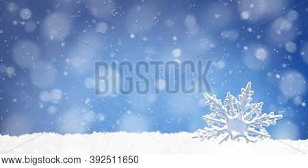 Toy Snowflake In A Snowdrift On Blue Background, Copy Space
