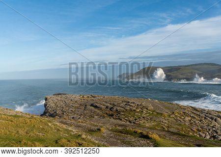 Huge Storm Surge Ocean Waves Crashing Onto Shore And Cliffs