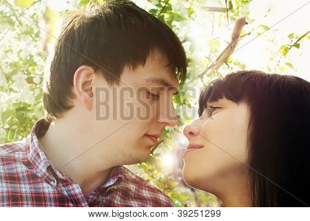 Closeup portrait of young couple looking at each other
