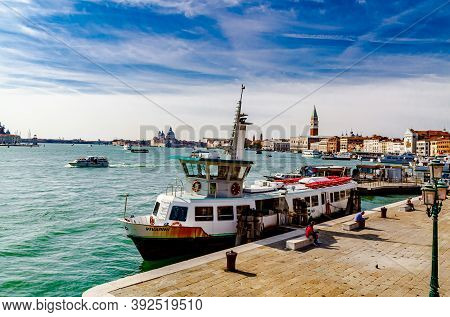 Venice, Italy - October 2017: Vaporetto At The Embankment Against The Backdrop Of The Palace Of Doge