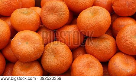 Fresh Tangerines, Close-up. Ripe, Juicy And Tasty Tangerines. Clementines. Tangerines Background.
