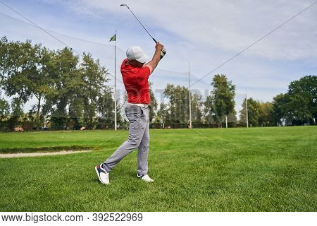 Diligent Professional Golfer Training On The Course