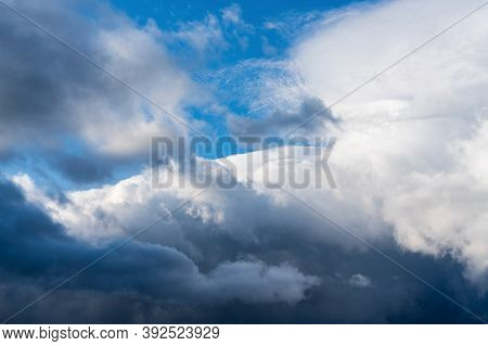 Dramatic Thunderstorm Clouds Floating In Blue Sky Before Rain. Majestic Cloudscape Background, Natur