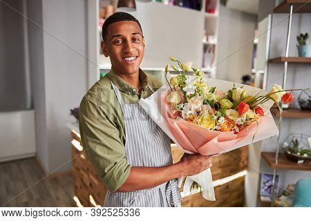 Joyous Floral Specialist With A Flower Bouquet