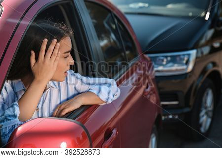 Young Woman Getting In Car Accident Outdoors
