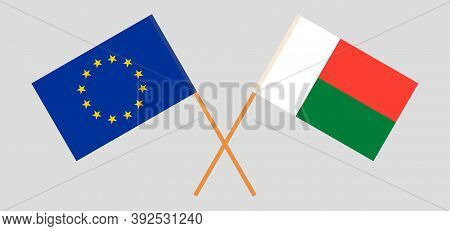 Crossed Flags Of Madagascar And The Eu. Official Colors. Correct Proportion. Vector Illustration