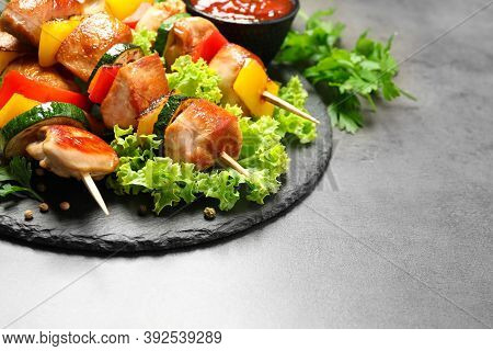 Delicious Chicken Shish Kebabs With Vegetables On Grey Table. Space For Text