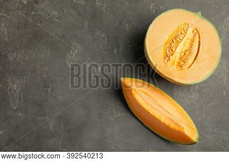 Tasty Fresh Cut Melon On Grey Table, Flat Lay. Space For Text