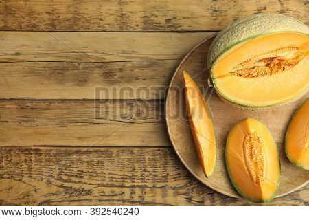 Tasty Fresh Cut Melons On Wooden Table, Top View. Space For Text