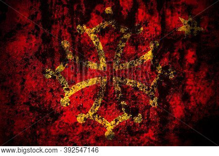 Occitania Flag On Grunge Metal Background Texture With Scratches And Cracks