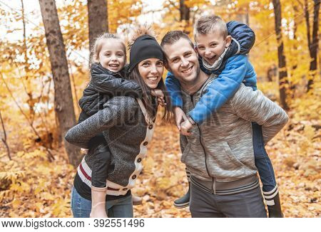 A Portrait Of A Young Family In The Autumn Park