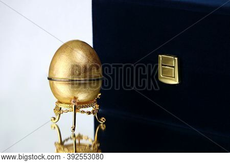 One Golden Egg On White Background. Gem. Background Gold Concept. High Quality Photo