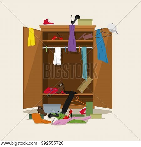 Open Wardrobe With Mess Clothes. Closet With Untidy Clothes, Dresses, Shirts, Boxes And Shoes. Natur