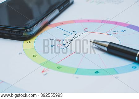 Printouts Of Astrological Charts, Tables, Diagrams Lying On The Table.