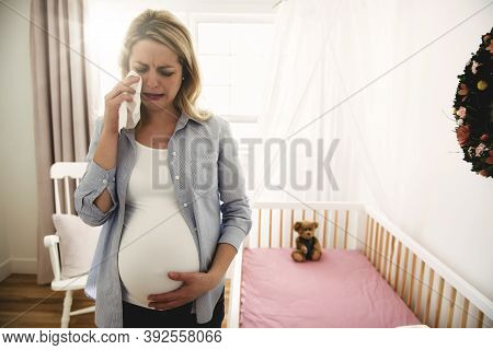 Pregnant Woman With A Lot Of Stress At Home Crying With Tissue