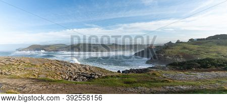A View Of Huge Waves Crashing Onto The Shores Of Cabo De Ajo On The Northern Spanish Coast