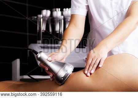 Foot Cavitation Massage Photo. Ultrasonic Liposuction Procedure.