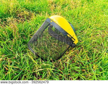 Protective Face Mask For Working With A Lawn Mower. Protective Mask. Trimmer For Cutting Green Grass