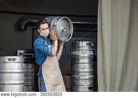 Industrial Production Of Craft Beer During Covid-19 Pandemic And New Normal. Young Handsome Man Work