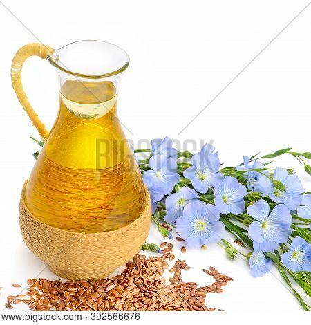 Linseed Oil, Flaxseed And Flowers Isolated On A White Background