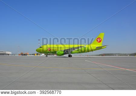 Saint Petersburg Russia. May, 17, 2014. Green Passenger Plane Airbus A319 Of S7 Airlines On The Runw
