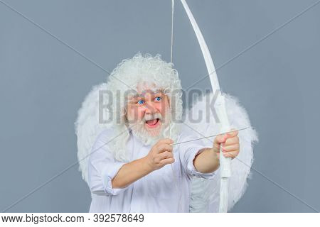 Cupid With Bow And Arrow. Valentines Day. Cupid Throws Arrow With Bow. Old Angel With Bow And Arrow.