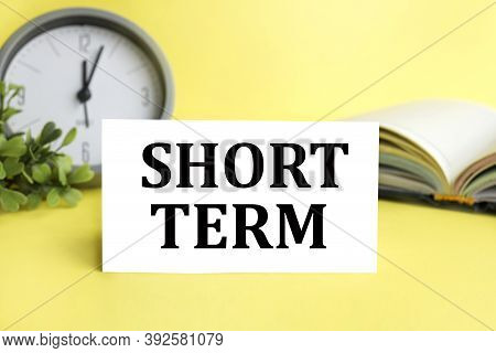 Short Term, Text On White Paper On Yellow Background