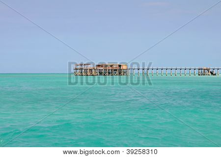 Wooden Pier With Turquoise Sea And Blue Sky
