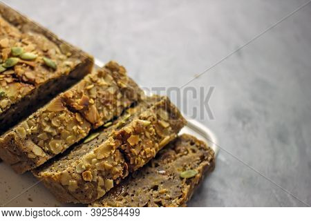 Gluten Free And Sugar Free Pumpkin Bread Cut Into Pieces. Pumpkin Cake With Dried Fruits, Poppy Seed