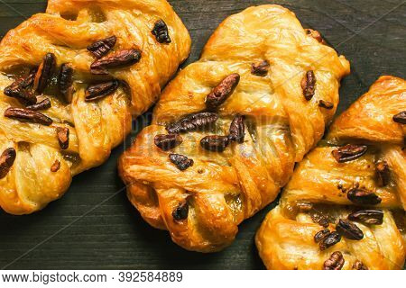 Danish Pastry Maple Pecan With Nuts And Maple Syrup. Close-up.